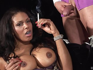 Classy busty ebony smokes while getting pussy subdued