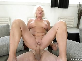Cruel granny sits her shaved old pussy down her high horse dick