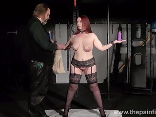 Chubby woman in stockings and garters Kitty is punished with apparel pins