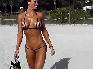 Extreme gruff bikini cameltoe string on beach