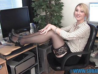 Horny chick Katie K wears stockings while fingering her pussy